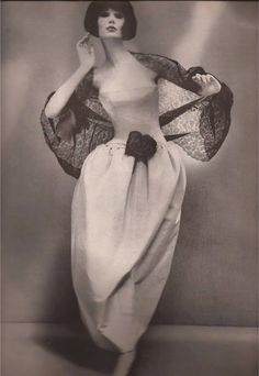 Dior's Madrilena Dress of floating pale gray faille Alexandre of Paris Coiffure Photo by Richard Avedon