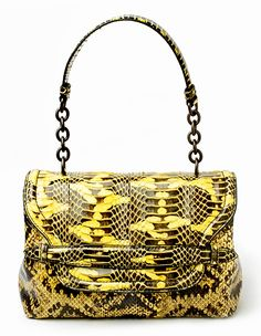 The new chartreuse Mangrovia Ayers by Bottega Veneta bag will bring a pop of bold color to your more neutral Fall look.