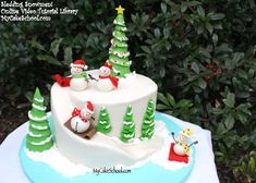 Learn to make an adorable winter-themed snowman cake with carved cake slope in this Sledding Snowmen Cake Tutorial by My Cake School! Cake Decorating Classes, Cake Decorating Tutorials, Cookie Decorating, Noel Christmas, Christmas Treats, Christmas Baking, Christmas Cakes, Christmas Cake Decorations, Holiday Cakes