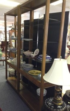 Mid Century Modern Shelf Units. Light and airy with gilded fruit wood supports and glass shelves. Puts the spot light on your beautiful collections.