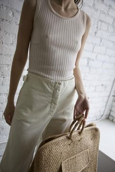 """Ribbed cream tank Keyhole button detail at back collar 100% Silk Approximate Measurements: Length 23"""" Width 11"""""""