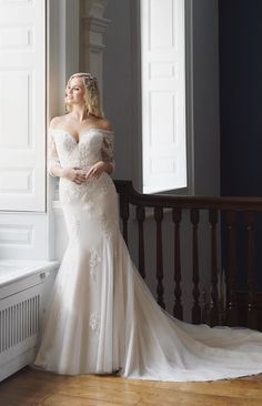 Fishtail style lace wedding dress featuring an off the shoulder neckline and stylish elbow length sleeves with a tulle train. Wedding Dress Outlet, Dream Wedding Dresses, Lace Wedding Dress With Sleeves, One Shoulder Wedding Dress, True Bride, Designer Wedding Gowns, Carlisle Cumbria, Dresses For Sale, Bridal Gowns
