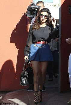 Knock, knock: Kourtney arrives for the casual lunch... armed with a camera crew