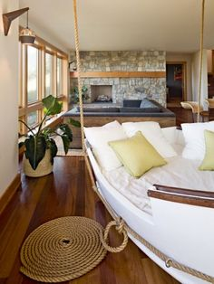 Boat transformed into a day bed that hangs from the ceiling.