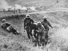 KOREAN WAR: WOUNDED, 1950. U.S. Army soldiers of the 9th Infantry aiding a wounded comrade. Photographed 1950.