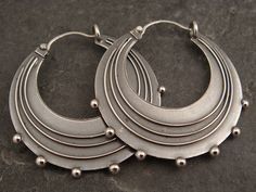 """I often get requests for larger versions of my small hoops but this is the first time I have actually made a bigger pair. The customer is a belly dancer and wanted these for her costume. These hoops are all sterling silver and measure 1 1/4"""" in diameter. They were given a patina and then tumbled for a high shine finish. The opposite sides are the same as these."""