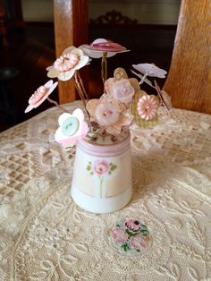 A vintage salt shaker button bouquet.  DIY at myrusticromanticandrepurposedlife.com