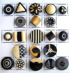 ART DECO CELLULOID BUTTONS  IN BLACK,  WHITE & CREAM.