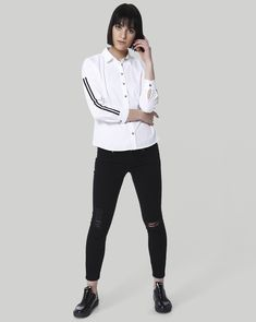 8490af704ef Androgyny meets athleisure with this white tape detail shirt from Vero  Moda. A sporty-