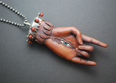 "Leah Hardy, 'Himalayan Deity Amulet' Necklace in terracotta, glaze, and sterling silver. Necklace is 28"" in length. Pendant measures 3.5 x 1.5 x 0.75"""