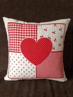 A red and white patchwork heart cushion A lovely patchwork cushion featuring a heart design Each panel is cut from carefully chosen fabrics and then Applique Cushions, Sewing Pillows, Diy Pillows, Decorative Pillows, Throw Pillows, How To Make Pillows, Patchwork Heart, Patchwork Cushion, Quilted Pillow