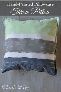 These hand-painted throw pillows are fun to make, easy to customize and an inexpensive room update!