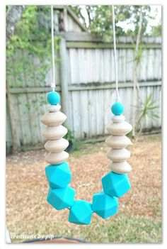 Check out this item in my Etsy shop https://www.etsy.com/au/listing/490866447/turquoise-silicone-and-natural-wood-bead
