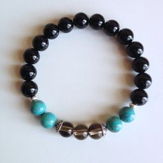 Astrology ~ Capricorn Sign ~ Genuine Turquoise, Smokey Quartz & Black Onyx Bracelet w/ Sterling Silver Caps and Hill Tribe Spacers on Etsy, $26.00