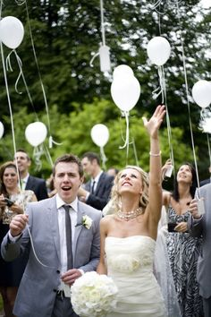Release balloons at your wedding to honor lost loved ones. Such a magical idea!