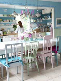 Perfect candy coloured kitchen. Those chairs are awesome - An Inspiring Painted Kitchen in Pastel Hues and Candy Colours