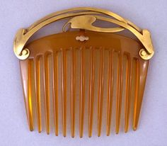 Factory of: Theodor Müller, Designed by: Henry Clemens van de Velde.  Gold openwork mount riveted to a tortoise-shell comb. Circa 1903. (British Museum)