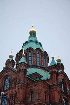 """""""The characteristic 'onion shapes' of the Russian orthodox churches top the Uspenski Cathedral in Helsinki. They are unusual in being smaller than the tower diameter, where as the domes usuall exceed the diameter of the tower, such as for example the domes of St. Basil's on Moscow's Red Square"""" - quote from photographer. Finland Helsinki DSC_3649 by youngrobv (Rob), via Flickr"""