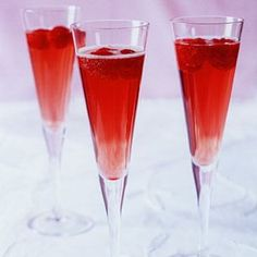 Raspberry Champagne Cocktail : In small bowl mix 4oz fresh raspberries, 3Tbsp creme de cassis. Let stand at least 30min. Divide berries among 6 champagne flutes; top with (1btl) chilled dry champagne. May add 3/4-1tsp grenadine to each glass if desired.