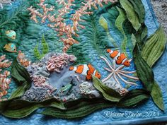 I could pin from this site all day!   The Nifty Stitcher: Hand Embroidered Tropical Fish Wall Hanging - Finished!