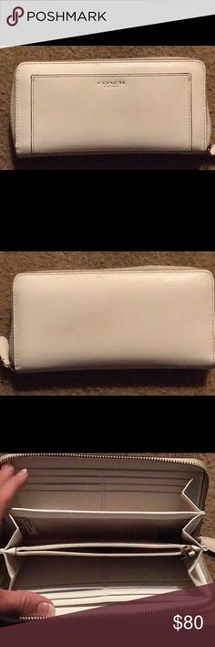 Authentic Coach White Leather large zip wallet. Authentic, clean and like new. The best wallet of all! Zip close and lots of pockets just like new! Coach Bags Wallets