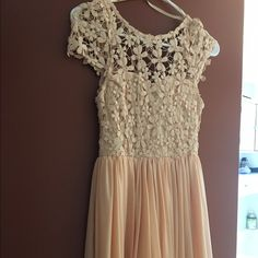 Dress Pretty spring dress! Perfect for graduations and Easter! Never been worn! It's a light pink cream color. UK size 8 US size 4 Dresses Mini