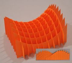 The graceful surface of a hyperbolic paraboloid comes across in this model. It is easy to see the two sets of parabolas that make up the curve. (The hyperbolas are harder to see!) The model flexes and can even fold flat.