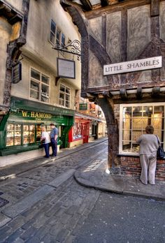 This is no movie setting, it is a real street in York, UK. It's called The Shambles & Little Shambles, full of little quaint shops.