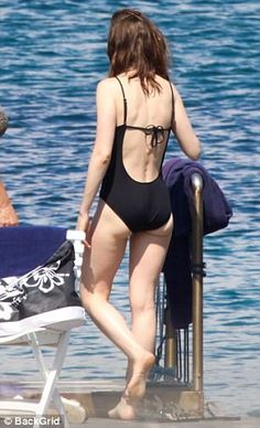 Another day in paradise: Lily Collins displayed her toned physique in a plunging blue swim...