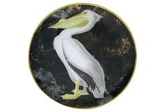 A pelican set against a granite-like background and rimmed with gold leaf. This piece is handmade in America by Victoria Fischetti