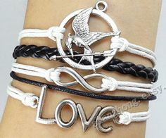 The hunger gamesmockingjay braceletcatching fire by Couplejewelry