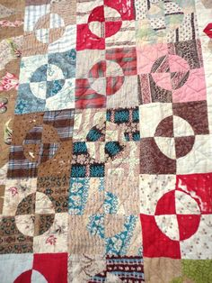 Tennants Auctioneers: Large 19th Century Quilt, with patchwork flowers to the central square, bordered by geometric patches, 260cm by 230cm