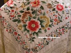 Mantón de Manila - A shawl, usually beautifully embellished with fine embroidery. Spanish and part of the flamenco tradition. Manta is a cloak and mantilla is a veil or lace worn at the back of the head.