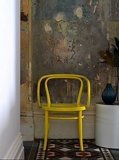 RP A mix of rustic and old with a pop of modern and color.  A yellow Thonet No B9 Le Corbusier Chair