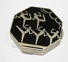 I LOVE this one! Black and Silver Art Deco compact