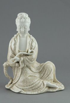 Chinese Dehua Blanc De Chin Kwanyin Marked. The serene expression Kwanyin holding a ruyi scepter, covered in fine crackles, the back with two stamp seal marked Dehua. H: 22 cm, W: 16 cm