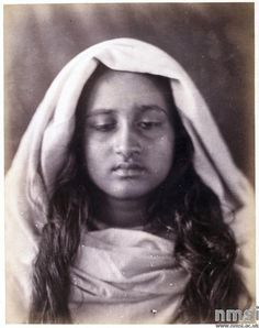 Description:  Albumen print by Julia Margaret Cameron, head of woman, Ceylon. A photographic portrait of a girl from Ceylon, (Sri Lanka) taken by Julia Margaret Cameron (1815-1879) in about 1877. She was probably a maidservant or plantation worker.  Object Number:  1985-5106 Credit Line:  National Media Museum, Bradford
