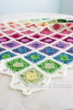 I think crocheting should be enjoyable and beautiful. This blanket is just that. Graphic simplicity of floating circles in squares makes for a clean and fresh design with motifs that can be worked on-the-go to the round just before they are joined. Add a rainbow of color and