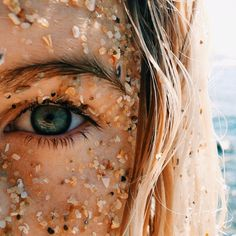 Don't put that on your face. Trust me. My sister and I did that once and the next few hours at home, our skin was stinging from the tiny scratches the sand and shell bits left. Don't do it.