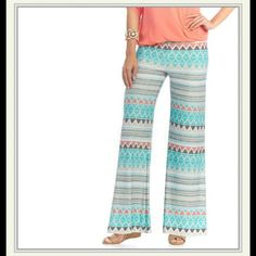 Soulmates printed flare pants Loose silky feel flare leg pants. 95% polyester 5% spandex. Colorful print with mostly teal, white, and some coral, black and gray. Worn once. Like new condition. soulmates  Pants
