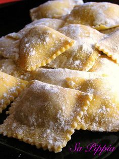 Culungionis alla Ricota, the Sardinian ravioli, filled with ricotta, and a hint of orange peel, and spinach, served with a simple tomato sauce and some pecorino sardo grated on top :-)