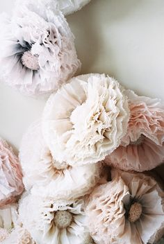 For a softer color, look no further than these large blush tissue flowers by Pompomblossom via etsy. Sweet and subtle, the flowers are hand dyed in blush, ivory, champagne, taupe, and grey. #altardecor #walldecor  #paperflowers