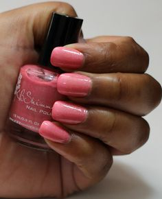 African American Hand holding Pink Holographic Nail Polish KBShimmer Blush Money