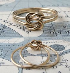 """Lovers Knot Ring - the association of knots with the symbolism of love, friendship, and affection dates back to antiquity. This particular type, often called the """"true lover's knot"""", was a popular ring style for sailors separated from their beloved. It's made by interlocking two overhand knots in two parallel wires, so each one is flexible to move about the other, yet they're inseparable forever."""