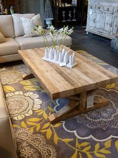 I think the hubby and I need to make a table like this...LOVE it!