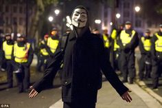 This protester was watched closely by several police officers in Parliament Square, London, during the Million Mask March Hacker Wallpaper, Sad Wallpaper, London Street, Aesthetic Pictures, Anonymous, Police, Bring It On, March, Bag Design