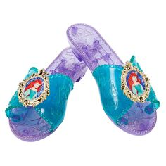 Our Disney Princess Ariel Dress-Up shoes is a must have for Disney Princess fans! Your little princess will get an extra bounce in her step with the Disney Princess Ariel dress-up shoes. These royal dress-up play shoes are safe and fun for little girls ages 3 and up. A great addition for Rapunzel costumes or dress up collections!