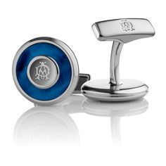 Sterling silver circular iconic cufflinks with blue mother of pearl.
