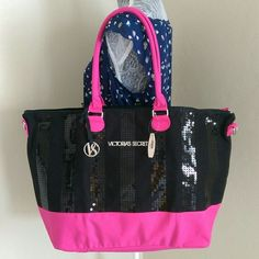 """Victoria Secret Weekend Bag This 2013 limited edition bag features black upper with black sequence and dark pink trims, dual drop handles with detachable shoulder straps, front signature silver plaque and """"VS"""" removable charm. Endless uses for this pretty weekender bag. Victoria's Secret Bags Travel Bags"""
