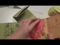 "This is the 2nd project from ""What's Up Wednesday"" It features an mini album made from 6 envelopes (#10) and chipboard covers. Visit my blog at http://followingthepapertrail.blogspot.com for measurements and instructions.    (c) Laura Denison The designs, pictures and instructions shown on this video are provided here for personal use only and m..."